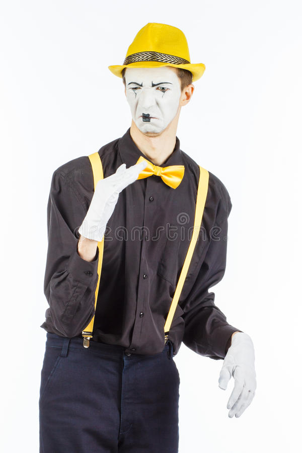 Portrait of a male actor, pantomime, covering his nose against a stock images