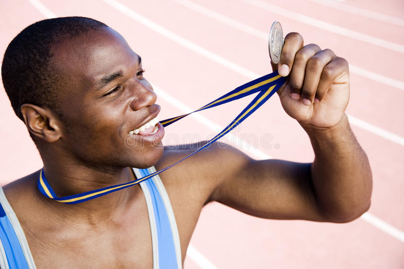 Portrait of a male athlete with his winning medal stock image