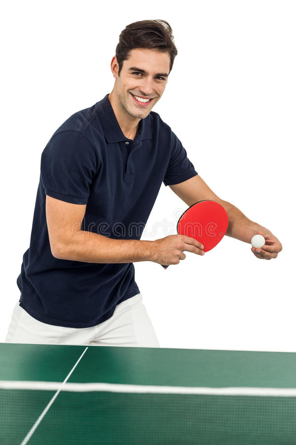 Portrait of male athlete playing table tennis royalty free stock photos