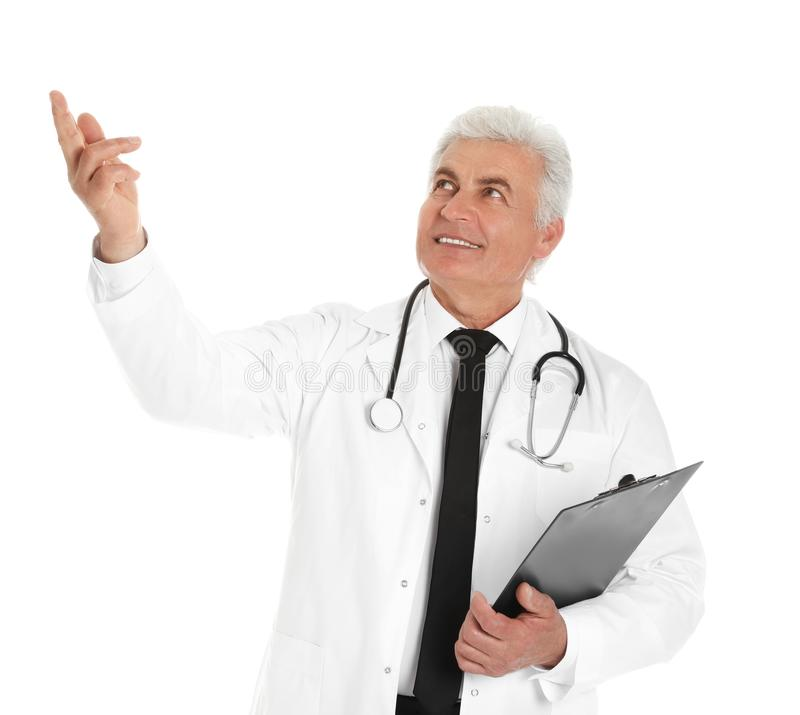 Portrait of male doctor with clipboard on white. Medical staff. Portrait of male doctor with clipboard isolated on white. Medical staff stock photo