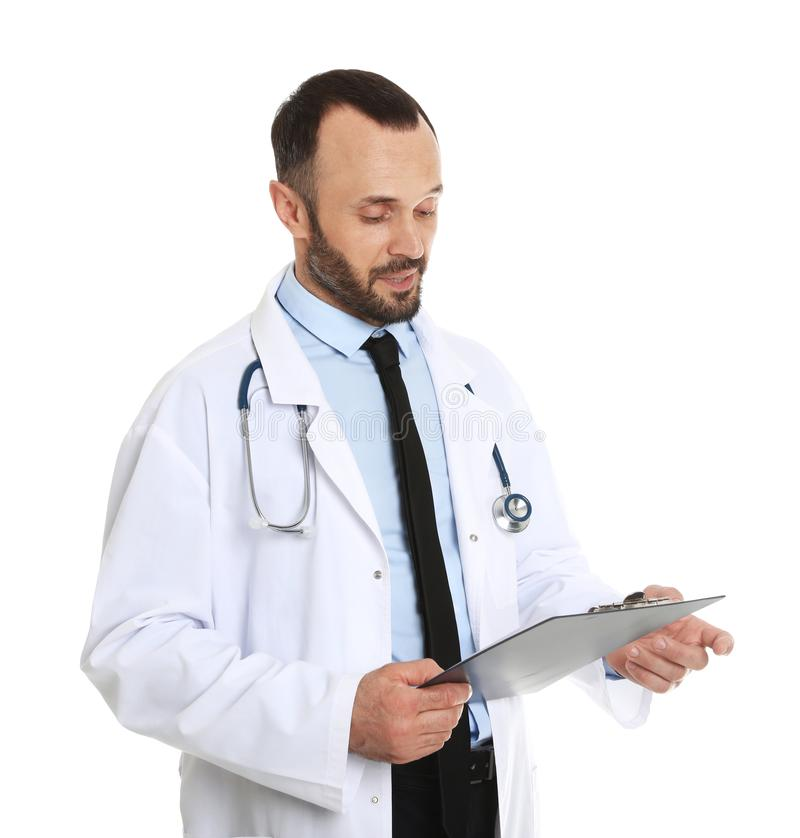 Portrait of male doctor with clipboard on white. Medical staff stock photo