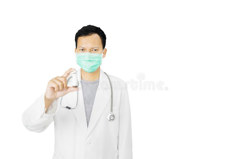 Portrait of male doctor holding a vaccine bottle royalty free stock images
