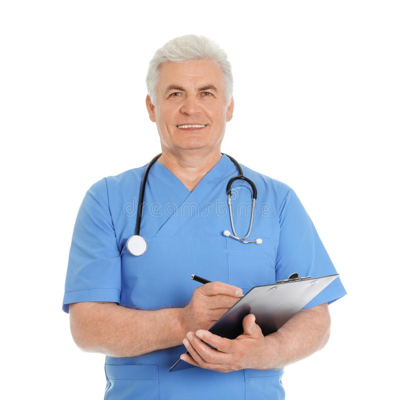 Portrait of male doctor in scrubs with clipboard. Isolated on white. Medical staff stock photo