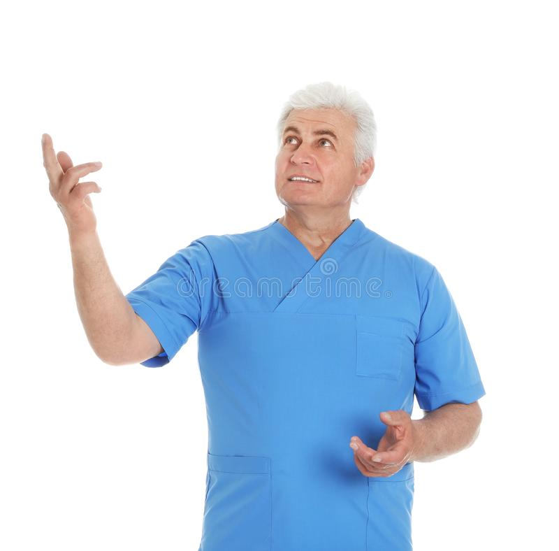 Portrait of male doctor in scrubs isolated on white. Medical staff stock images