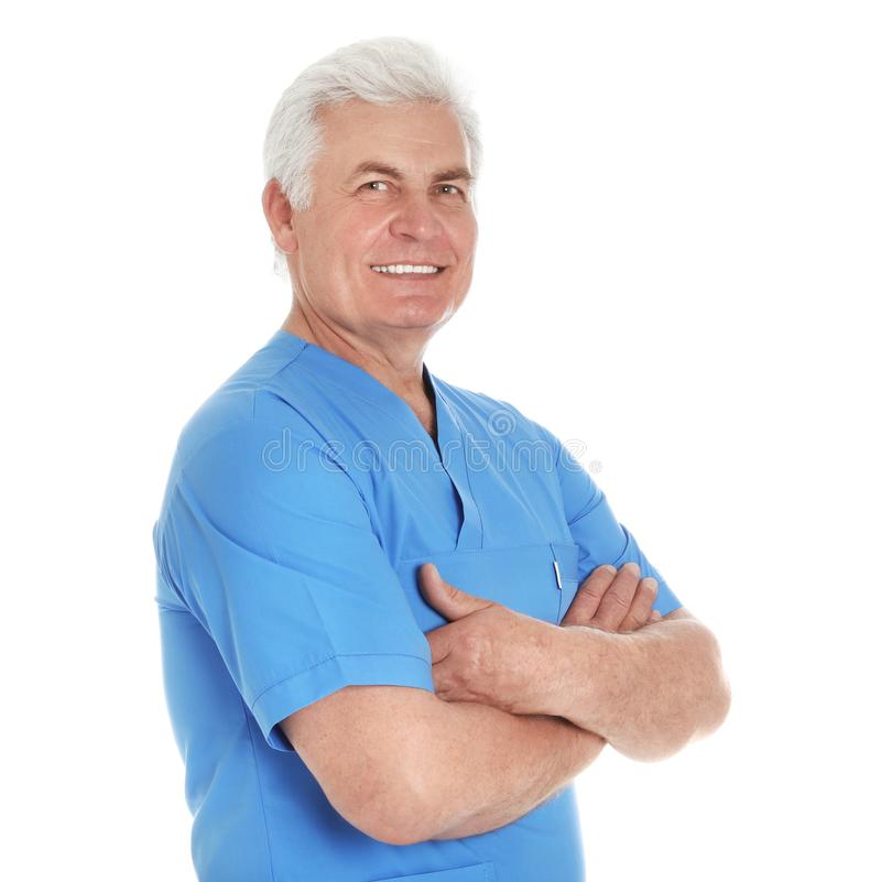 Portrait of male doctor in scrubs on white. Medical staff. Portrait of male doctor in scrubs isolated on white. Medical staff stock photo