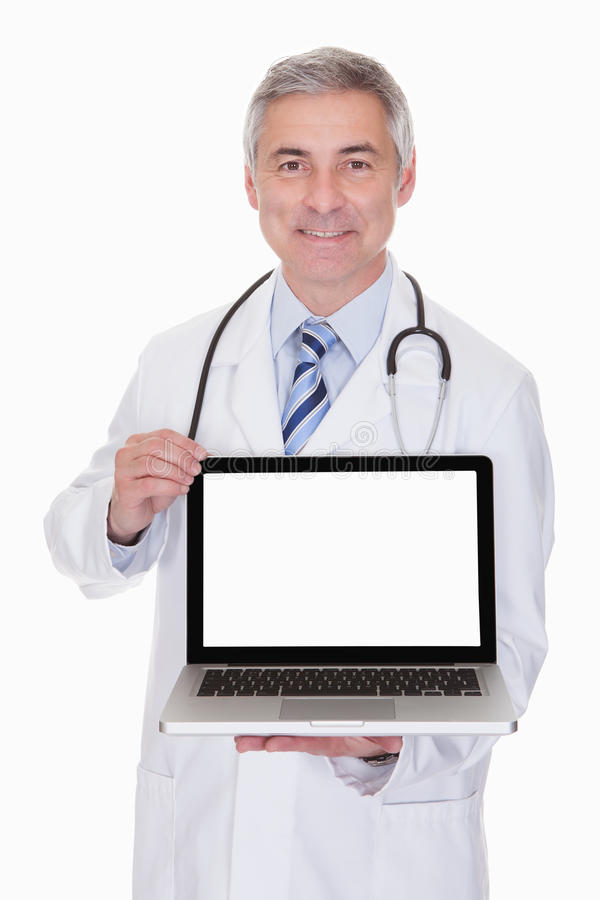 Portrait of male doctor showing laptop. Over White Background stock images