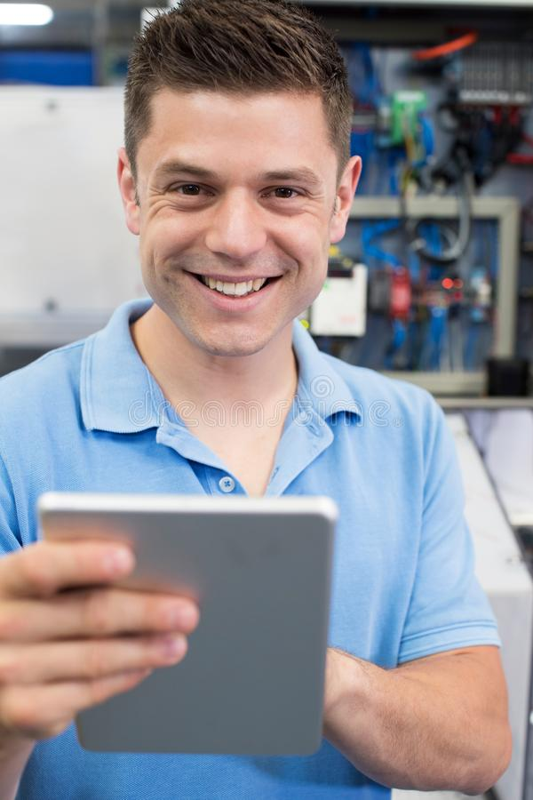 Portrait Of Male Engineer In Factory With Digital Tablet royalty free stock images