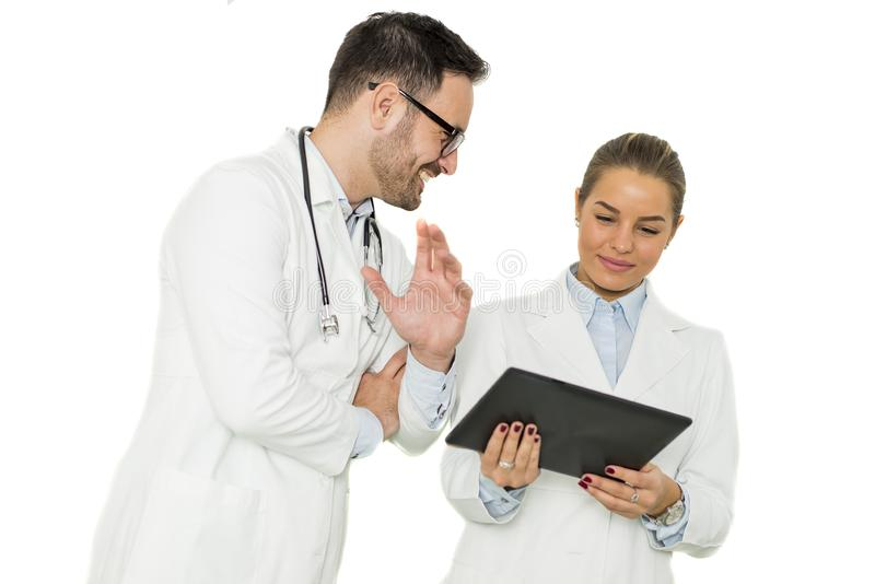 Portrait of male and female doctor stock images