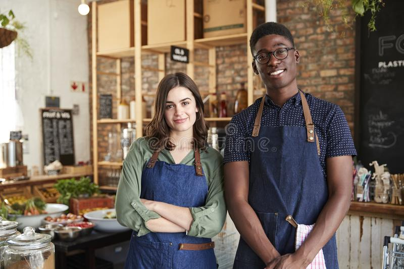 Portrait Of Male And Female Owners Of Sustainable Plastic Free Grocery Store stock photo