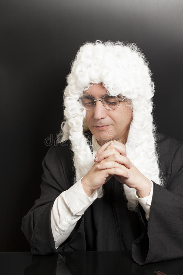 Portrait Of Male Judge in a wig on black. Background royalty free stock photography