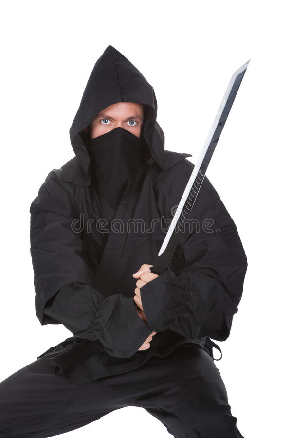 Portrait Of Male Ninja With Weapon. Isolated Over White Background royalty free stock image