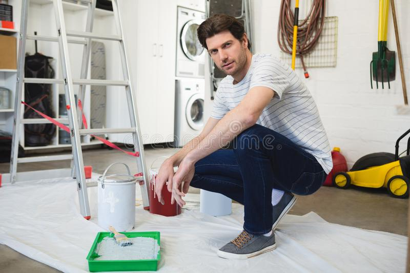 Male painter working in workshop stock images