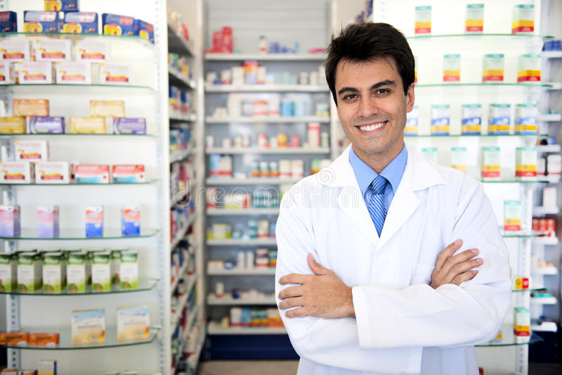 Portrait of a male pharmacist at pharmacy stock images