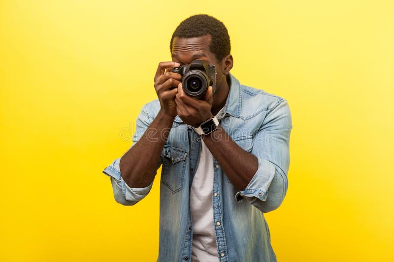 Portrait of male photographer or traveler in denim casual shirt holding professional digital dslr camera and focusing. isolated on. Portrait of male photographer stock photo