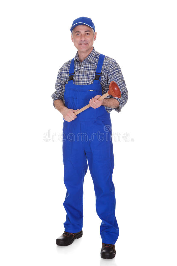 Portrait of male plumber holding plunger. Over White Background royalty free stock image