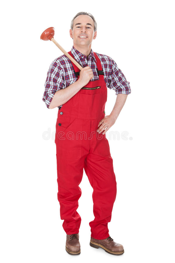 Portrait of male plumber holding plunger. ?over white background stock image
