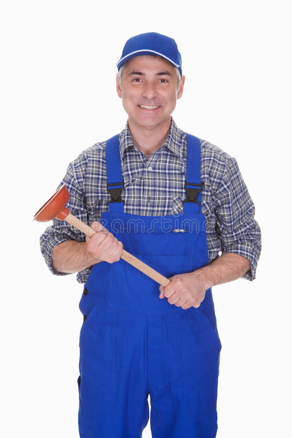 Portrait of male plumber holding plunger. Over White Background stock photography