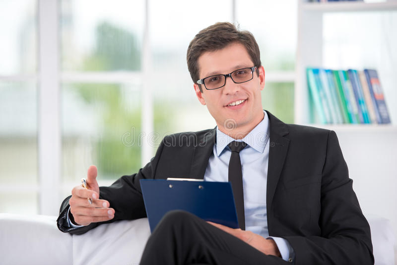 Portrait of male psychologist in office stock photo