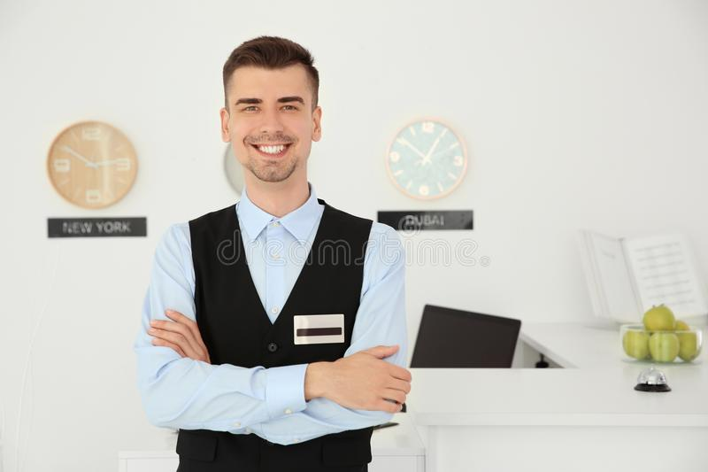 Portrait of male receptionist at workplace royalty free stock images