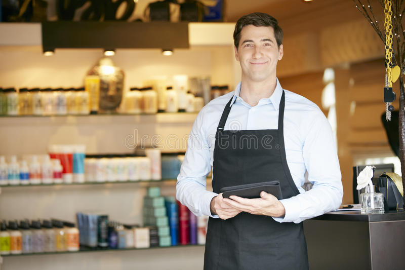 Download Portrait Of Male Sales Assistant In Beauty Product Shop Stock Photo - Image of shop, indoors: 54975654