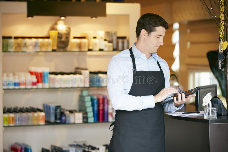 Download Portrait Of Male Sales Assistant In Beauty Product Shop Stock Photo - Image of checkout, caucasian: 55897446