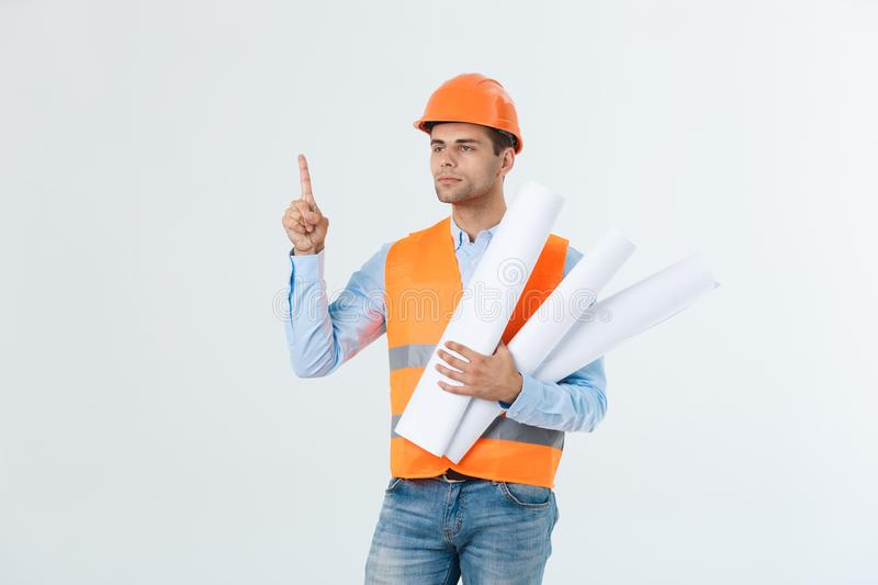 Portrait of male site contractor engineer with hard hat holding blue print paper. Isolated over white background. royalty free stock photo