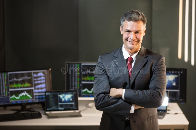 Portrait Of A Male Stock Market Broker. With Folded Arms royalty free stock image