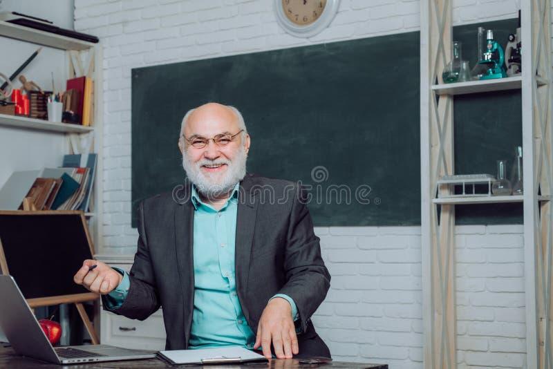 Portrait of male University Teacher indoors. Good tutors are often communication masters. Serious male Teacher studying stock photography