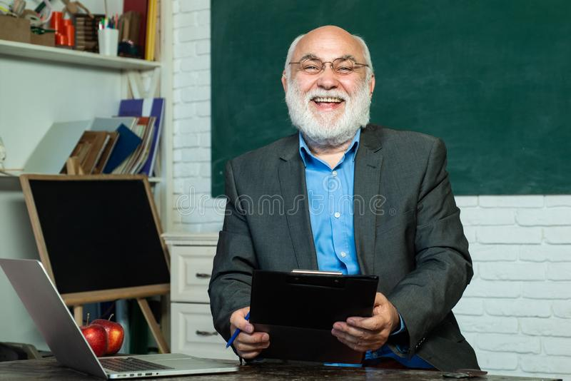 Portrait of male University Teacher indoors. Knowledge day. Teacher and tutoring education concept. Professor in class stock photography