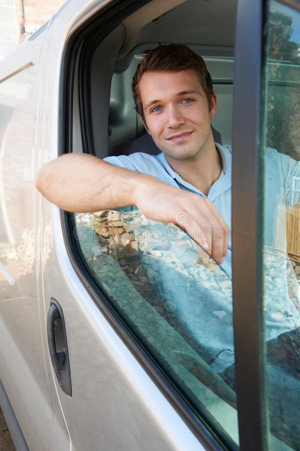 Portrait Of Male Van Driver. Behind Wheel stock photography