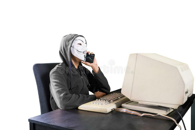 Portrait of man in anonymous mask calling someone stock image