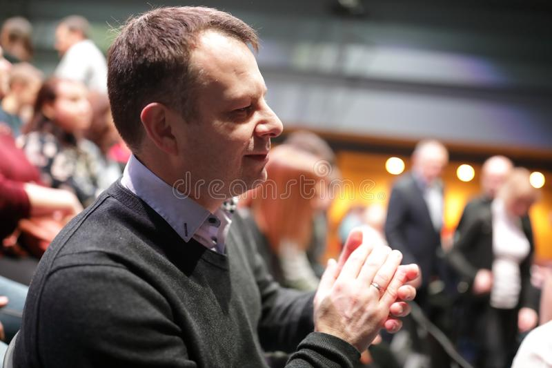 Man applauds in theater. Portrait of a man applauds in theater royalty free stock photos