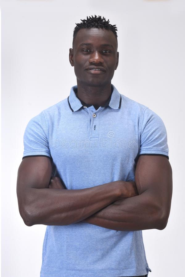 Portrait of a man with  arms crossed on white background royalty free stock photography
