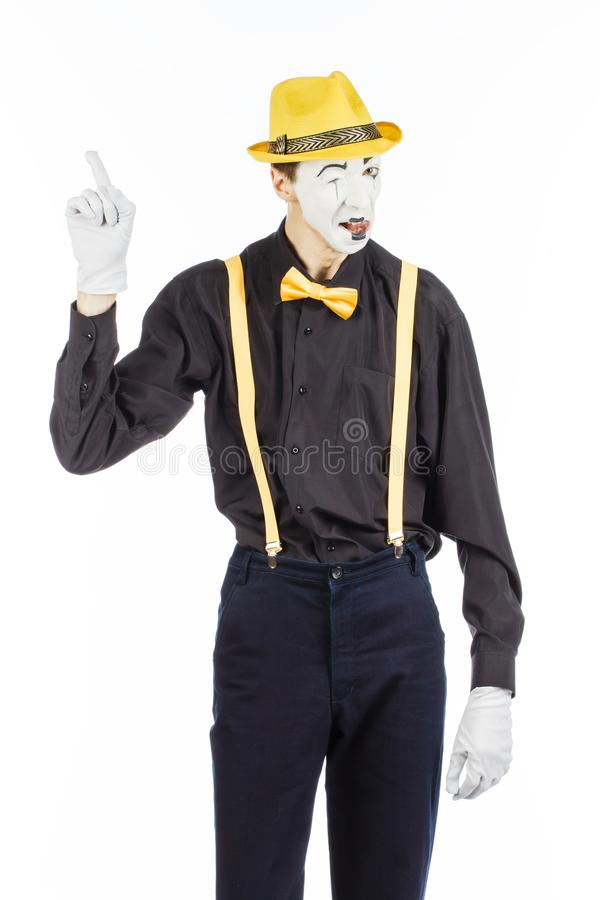 Portrait of a man, artist, clown, MIME. shows something. isolate stock photography