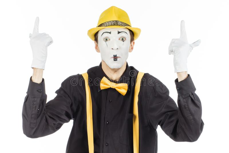 Portrait of a man, artist, clown, MIME. shows something. isolate royalty free stock image