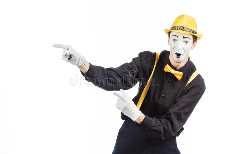 Portrait of a man, an artist, a pantomime. Shows something, isolated on white background stock photo