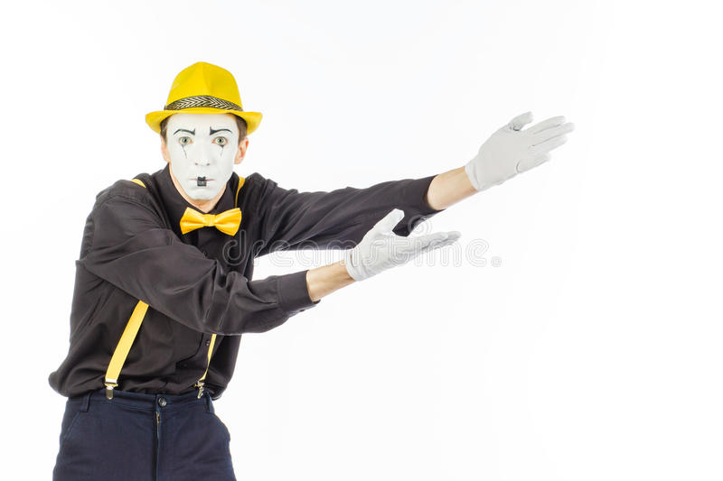 Portrait of a man, an artist, a pantomime. Shows something, isolated on white background stock photography