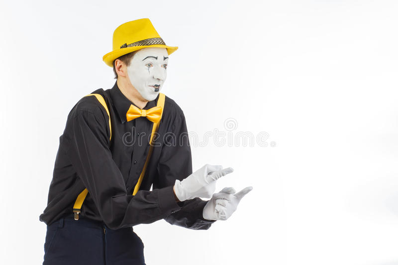 Portrait of a man, an artist, a pantomime. Shows something, on stock images