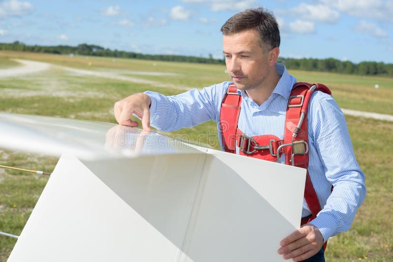 Portrait man assembling glider royalty free stock images