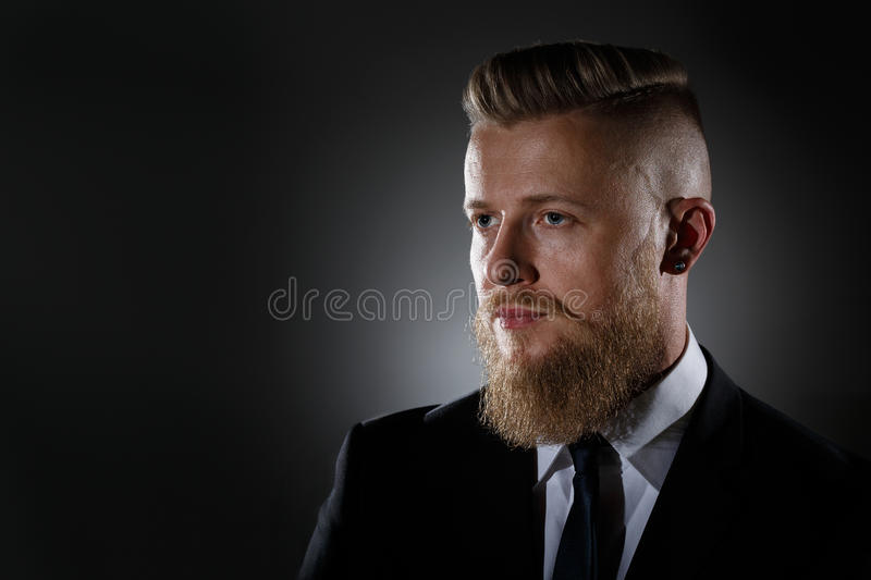 Portrait of a man with a beard in a business suit stock image