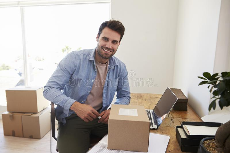 Portrait Of Man In Bedroom Running Business From Home stock images