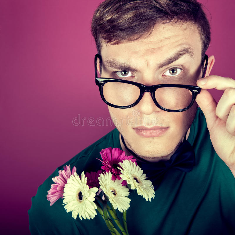 Portrait  of a man in big glasses with flowers