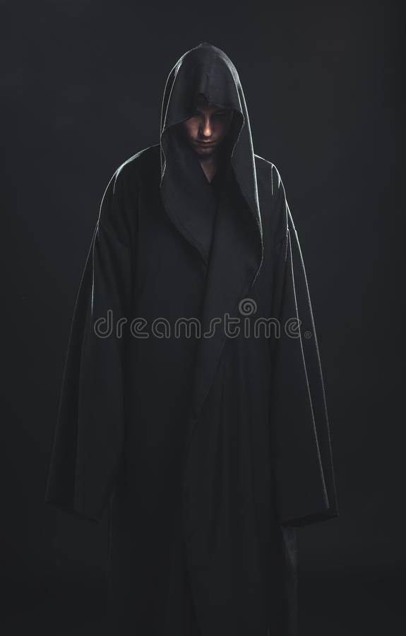 Portrait of man in a black robe royalty free stock images