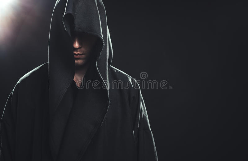 Portrait of man in a black robe royalty free stock image