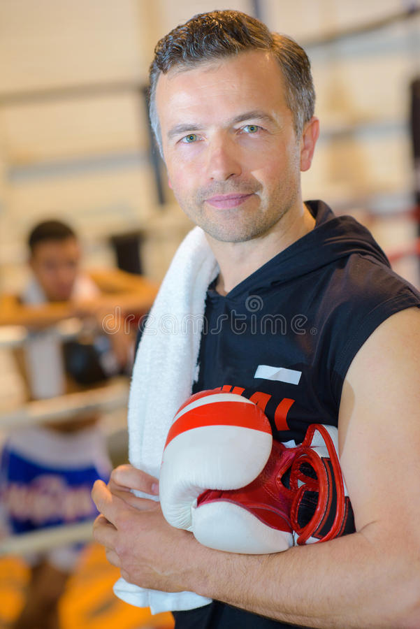 Portrait man with boxing gloves royalty free stock image