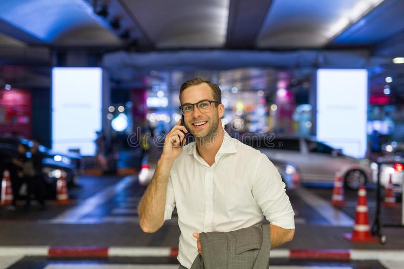 Portrait of a man in a business suit with a phone stock photography