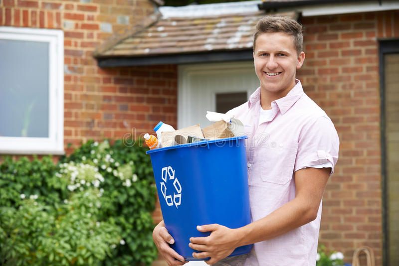 Portrait Of Man Carrying Recycling Bin royalty free stock photography