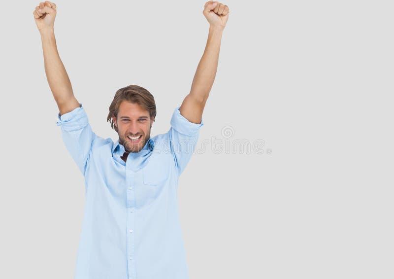 Portrait of Man celebrating with grey background royalty free stock image