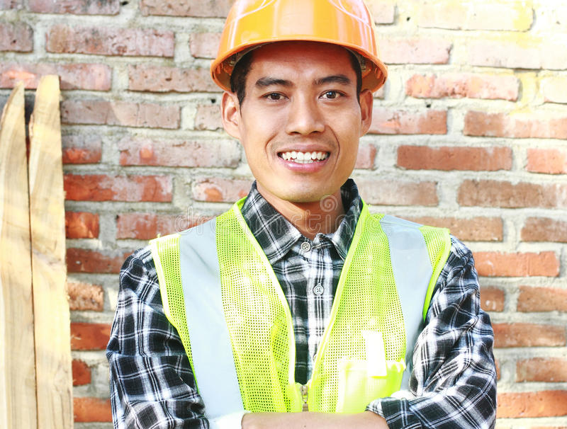 Portrait of man construction worker standing front of wall construction royalty free stock images