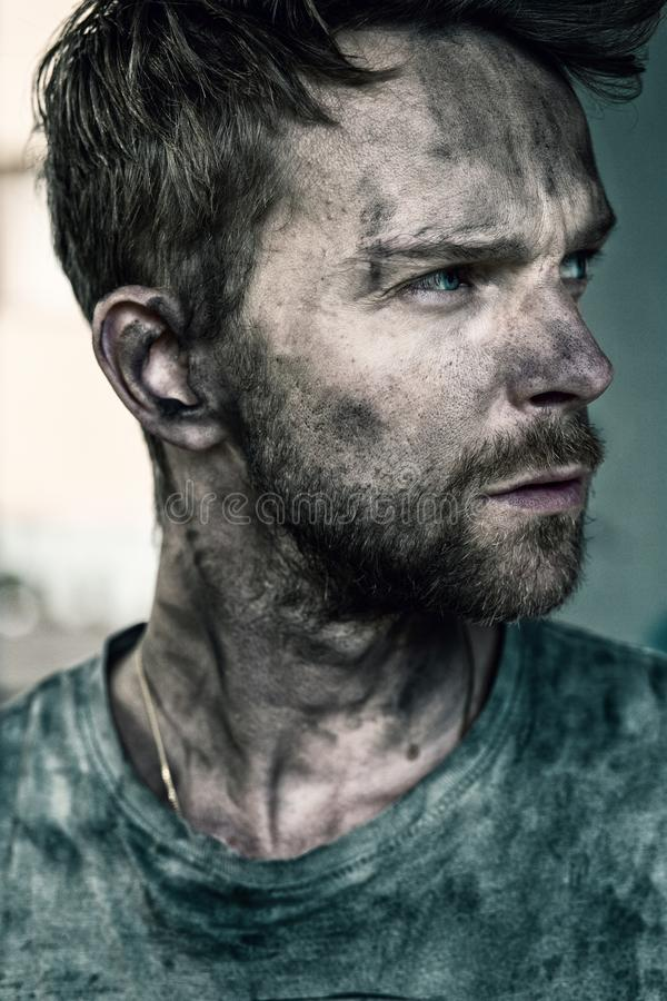 Portrait of man with dirt on face looking to the side stock photos